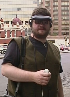 David Cox with wearable computer made from Macintosh Duo laptop,  Melbourne, 1997, copyright David Cox