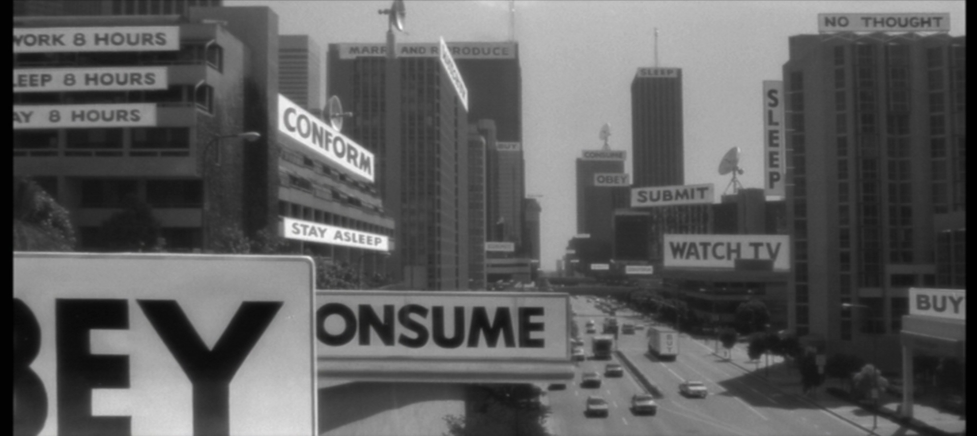 The view through the sunglasses in They Live—A political form of Augmented Reality revealing the true ideological basis of capitalism and its advertising.